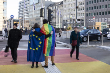 Young people with EU and LGBT flag